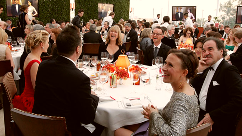 Dinner guests watch the awards. From Getty Images/V.F
